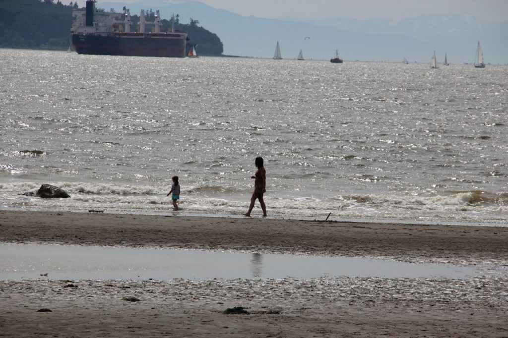 Walking along the beach, just after Stanley Park