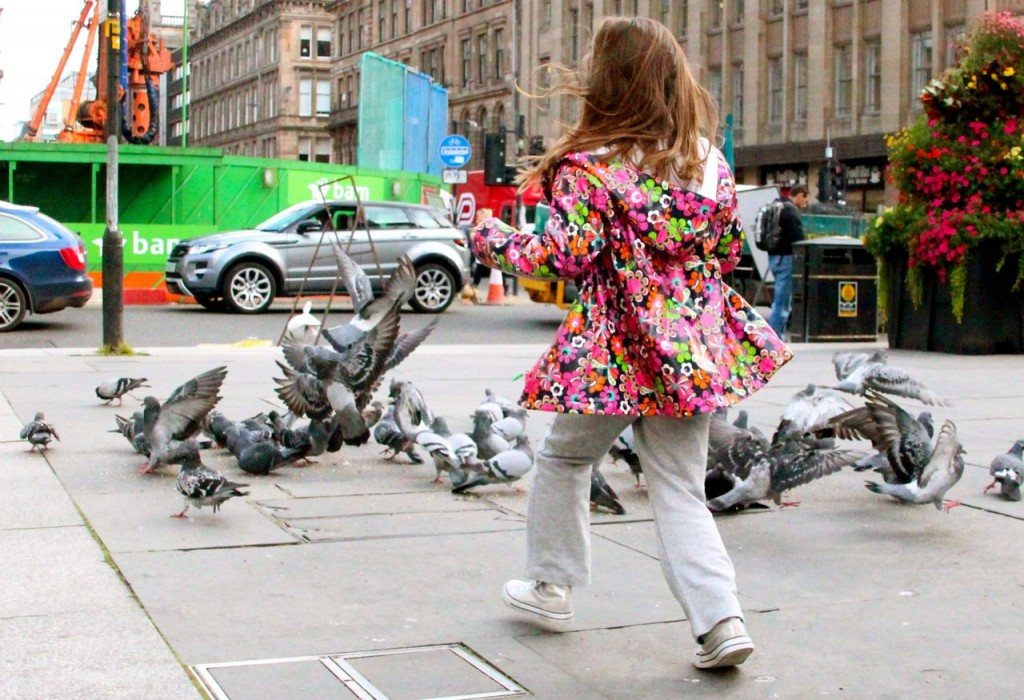 Angelina storms feeding pigeons