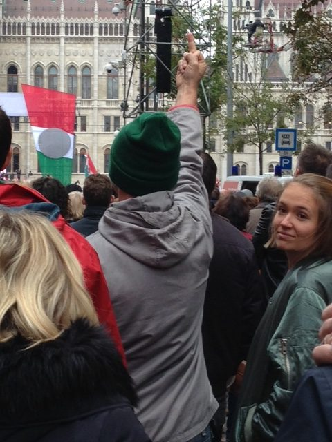 man fingers Orban at anniversary of revolution